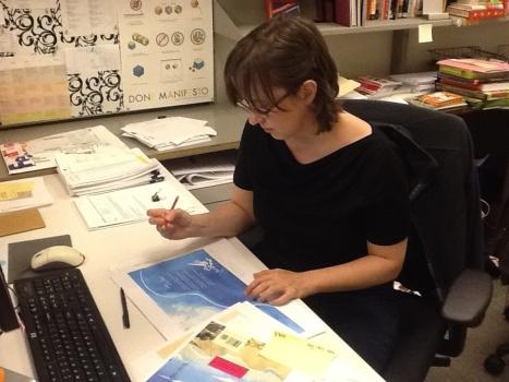 Melissa at her desk